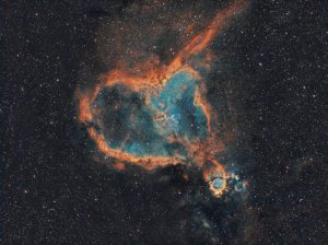 The Heart Nebula, IC 1805, Sharpless 2-190, lies some 7500 light-years away from Earth and is located in the Perseus Arm of the Galaxy in the constellation Cassiopeia. It was discovered by William Herschel on 3 November 1787. It is an emission nebula showing glowing ionized hydrogen gas and darker dust lanes.