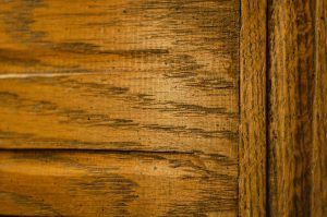 Woodgrain from an old desk. Each line and crevice seems to want to be parallel but just cannot get it right.
